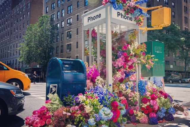 Upper West Side phone booth turned into flower bouquet by Lewis Miller Design team.