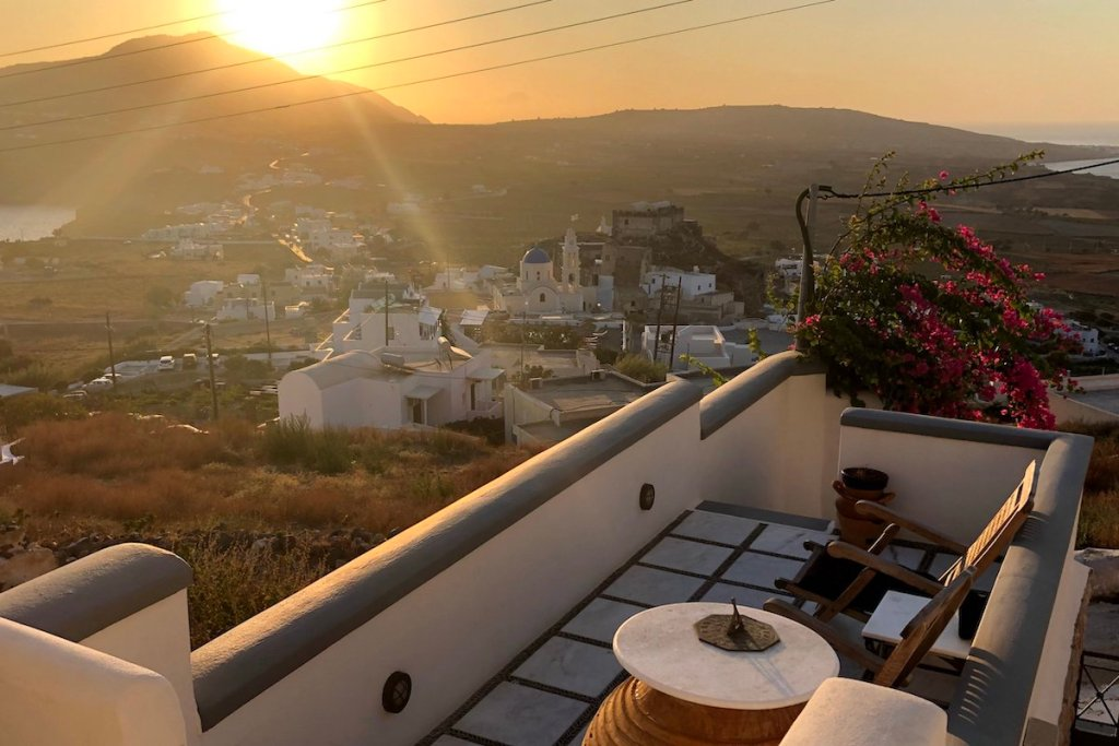 Sunset view to the Venetian Castle of Akrotiri, Santorini from Airbnb rental
