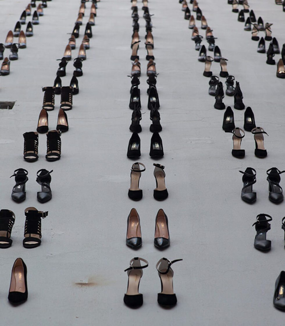Wall of black high heels