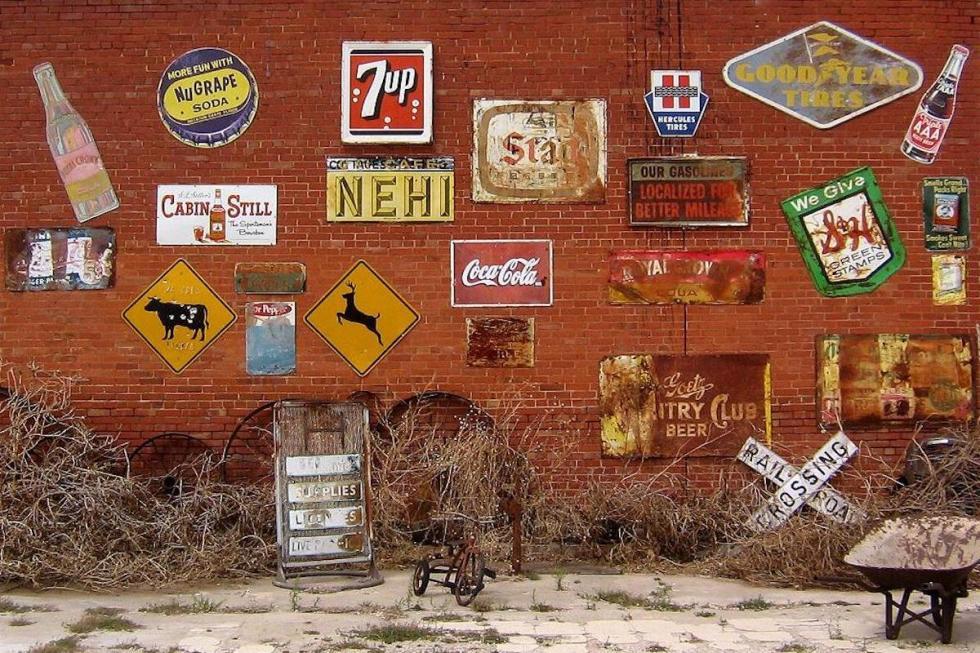 Sandhills Curiosity Shop exterior decorated with vintage signs