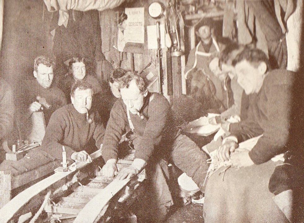 A group of explorers from Ernest Shackleton's Nimrod expedition, 1907-1909, in the Antarctic hut at Cape Royds