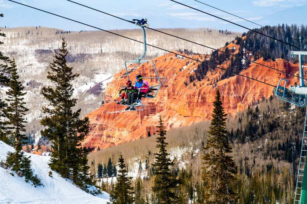 Family skiers on ski lift at Brian Head Resort in Southern Utah