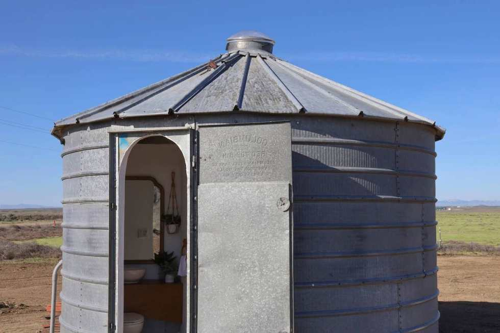 The Big Idaho Potato Hotel bathroom is located in an old grain silo about 50 feet from the rental's bedroom