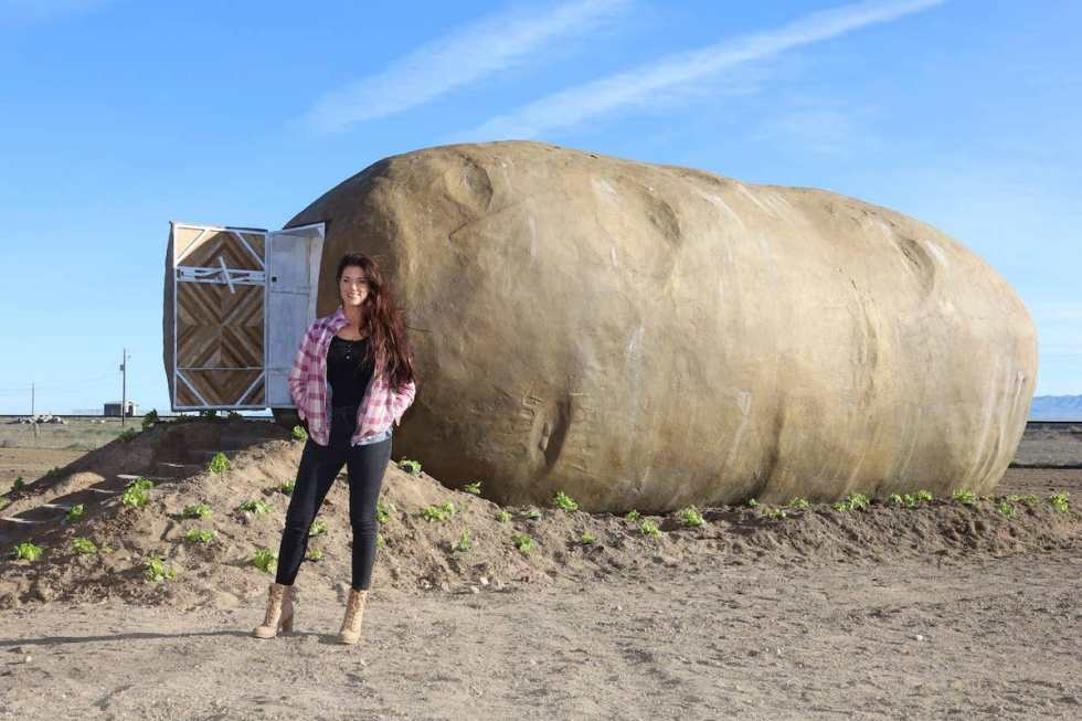 Big Idaho Potato Hotel owner and host Kristie standing outside her property