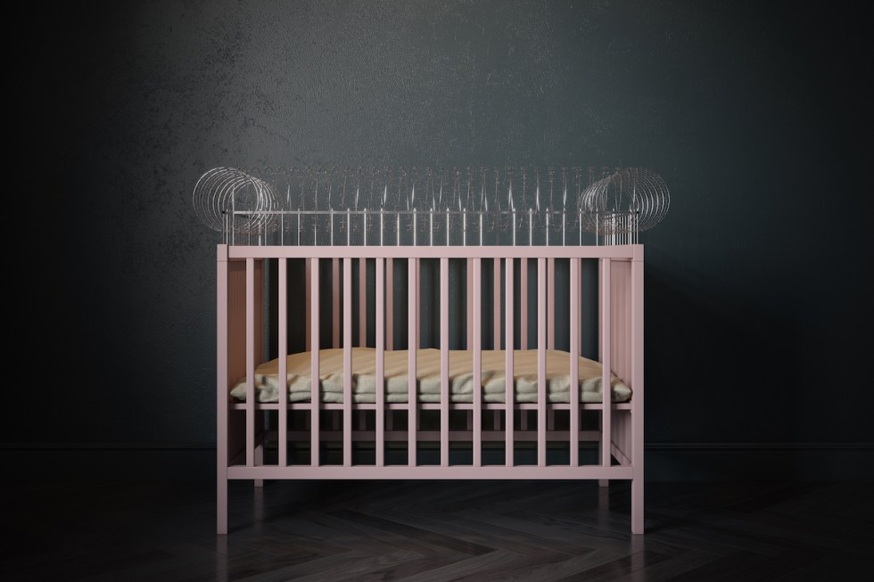 baby crib with barbed wire attached to it