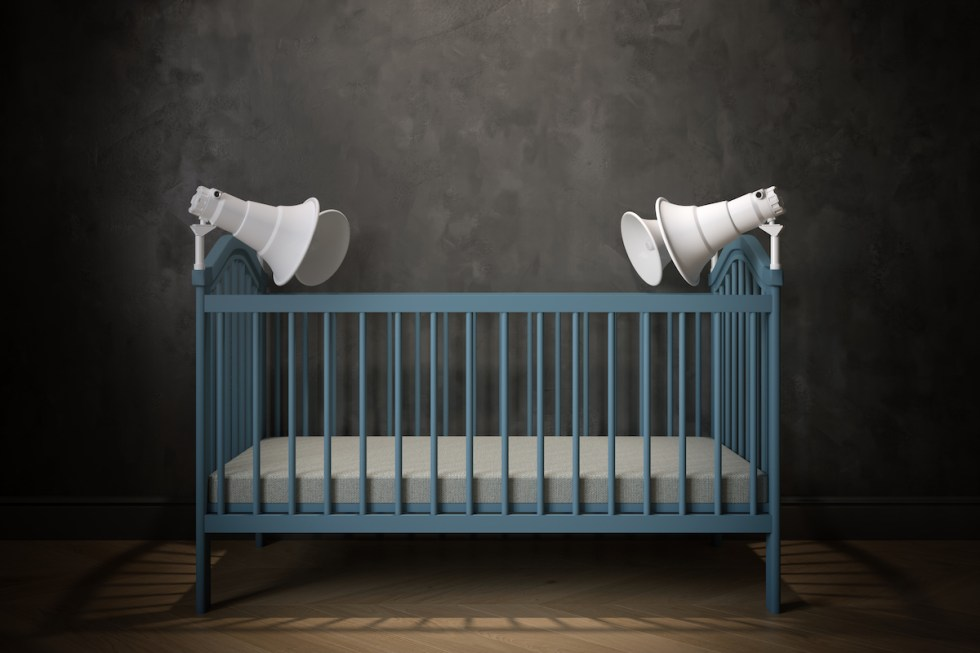 baby crib with megaphones attached to it