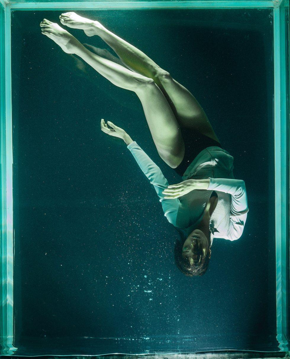 photo of woman underwater