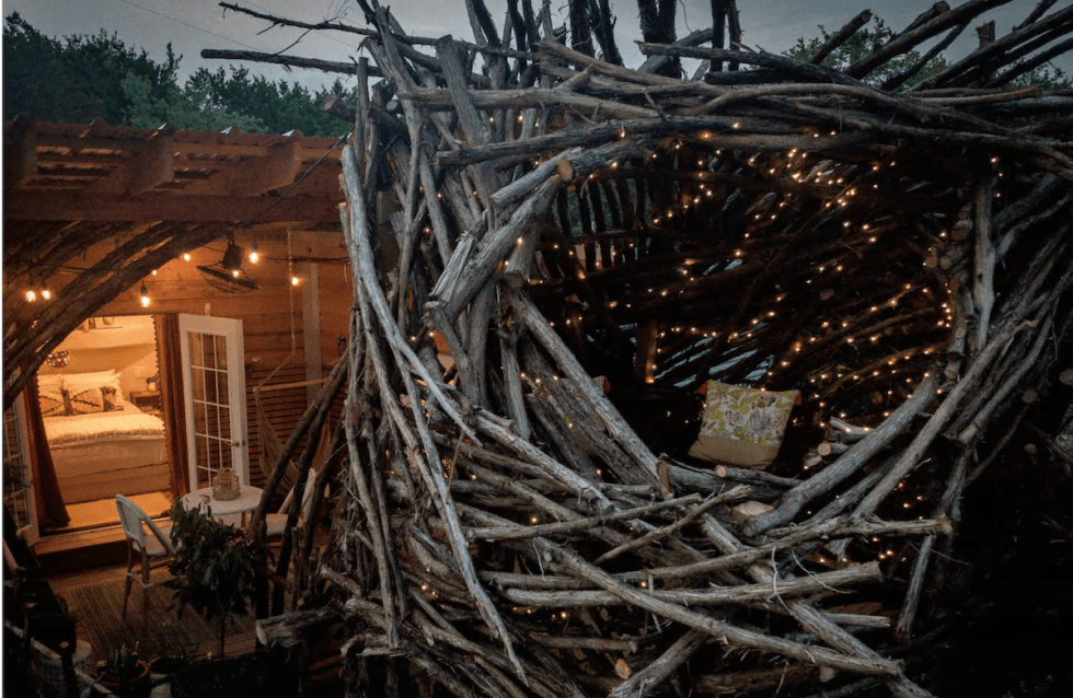 "quaint cabin, nicknamed ""The Nest,"" which looks like just like a bird's nest"
