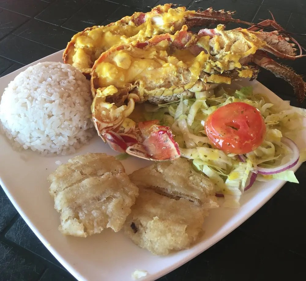 Lobster with rice, salad and plantains