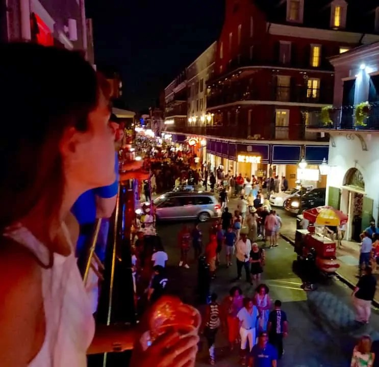 Watching the chaos unfold on Bourbon street from a balcony