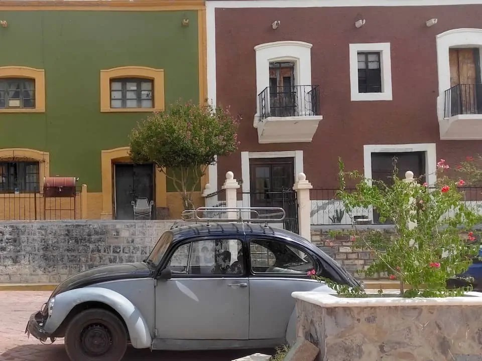 """A VW Bug parked in Mexico which is much better suited for driving in Mexico City under the """"Hoy No Circula"""" driving rules with the narrow roads and highways."""