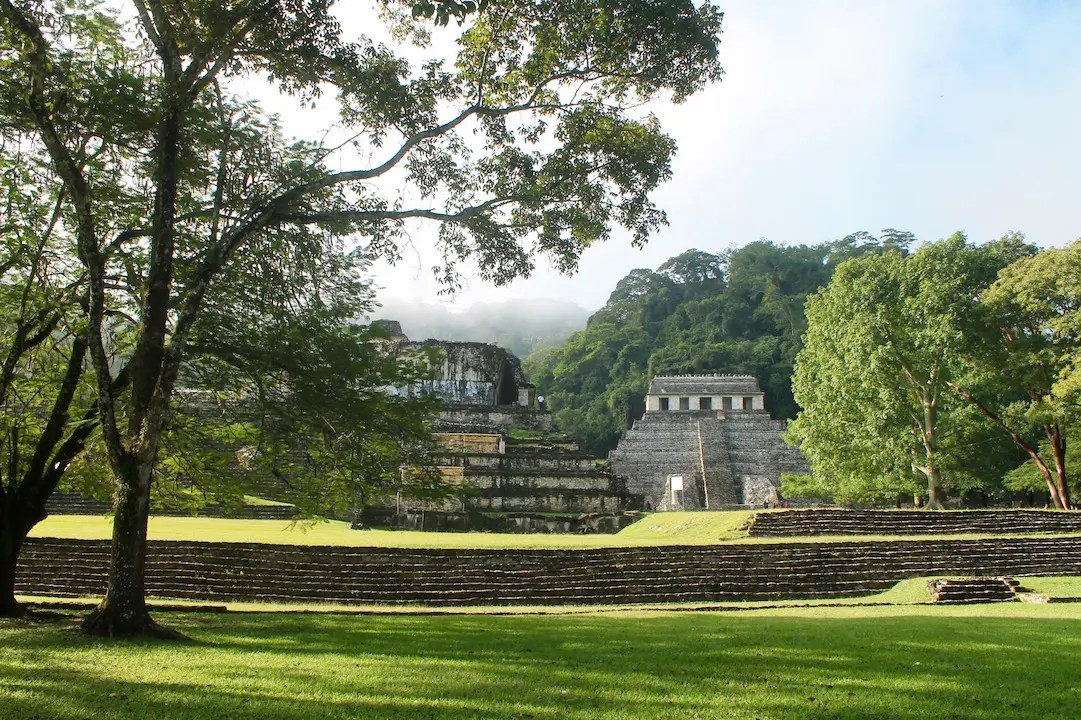 The ruins of Palenque shrouded in mist. A must see on a road trip of Chiapas