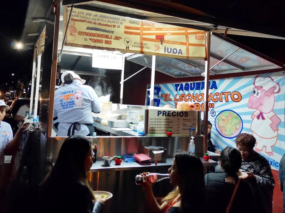 Discover where to eat in Oaxaca. Waiting in line at the taco stand at Lechoncito de Oro