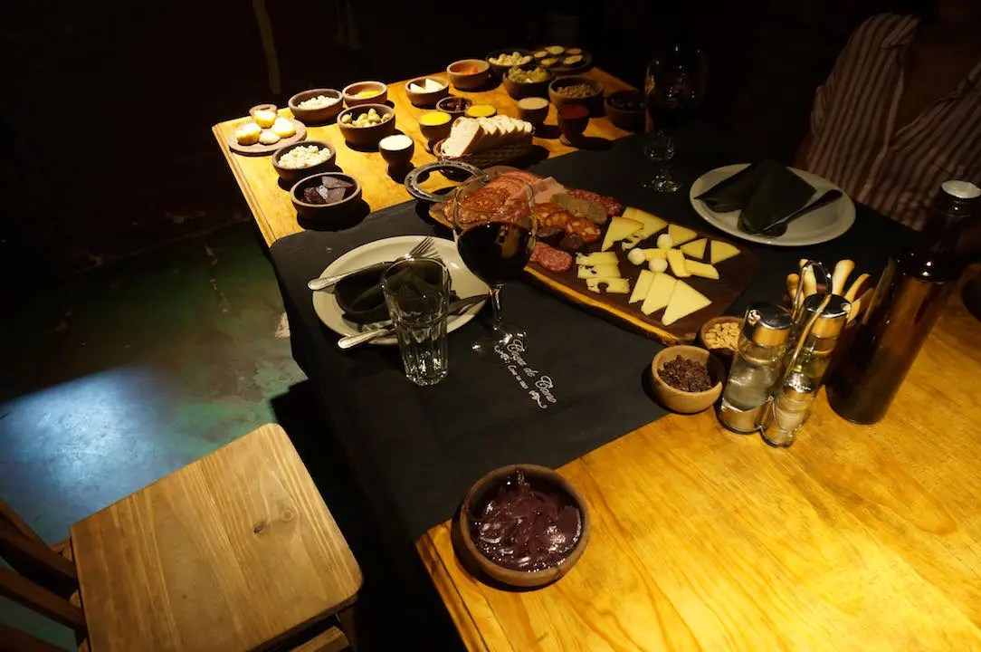 A picada of over thirty spreads including marinated beans, roasted vegetables, charcuterie and cheese board and more.