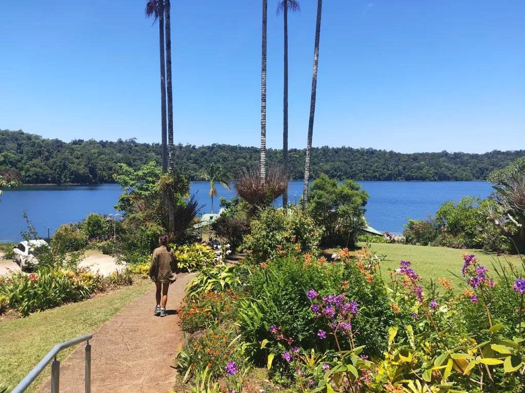 Walking through the gardens outside of Lake Barrine Teahouse at Lake Barrine in Crater Lakes National Park, Atherton Tablelands.