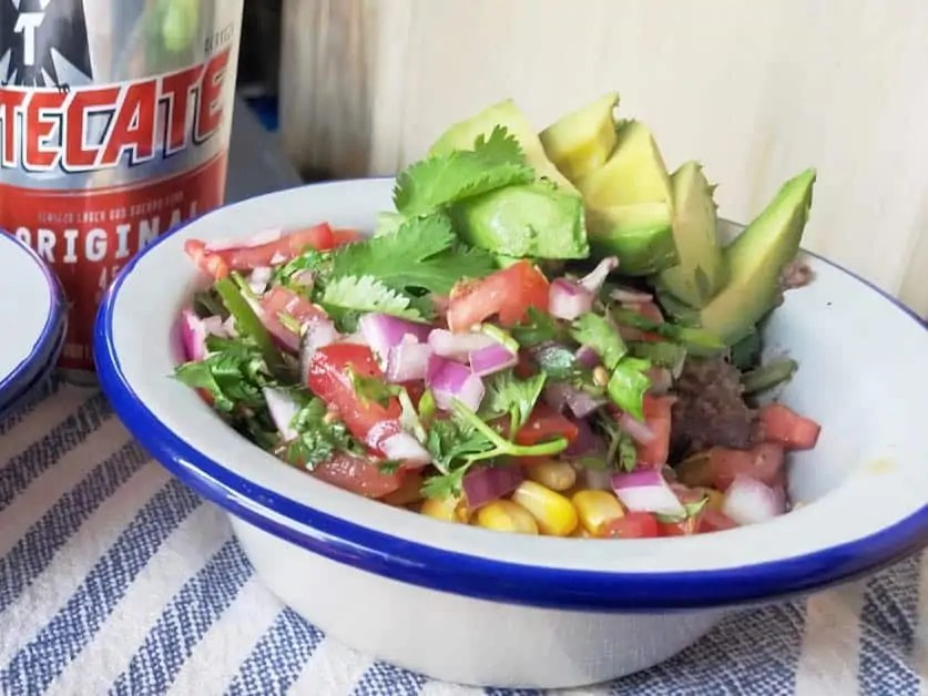 A bowl of Mexican Quinoa and Mexican beer