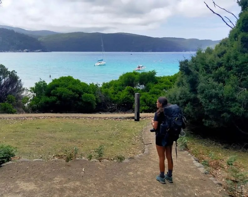 The image shows Kelli looking out over the beautiful water of Fortescue Bay, Tasman Peninsula.