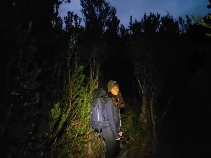 Kelli walking before sunrise along the Frenchmans Cap hike