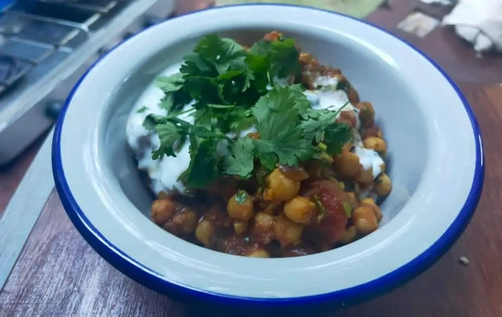 A bowl of easy Chana Masala a simple vegetarian Indian curry for van life