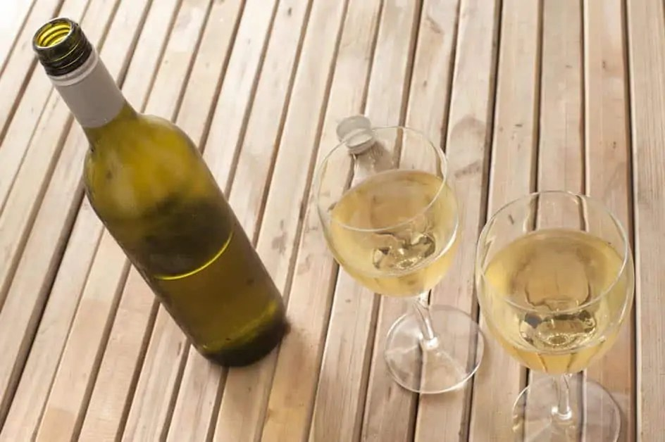 Two glasses and a bottle of chilled white wine. Sampling Bruny Island Premium Wines is one of the best things to do on Bruny Island.