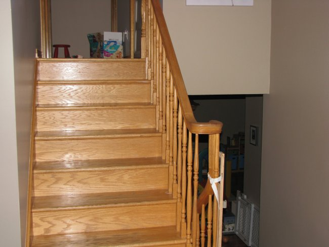 Oak stairs from a 1990s slit level fixer upper