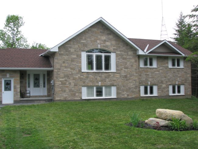 Raised bungalow with stone exterior