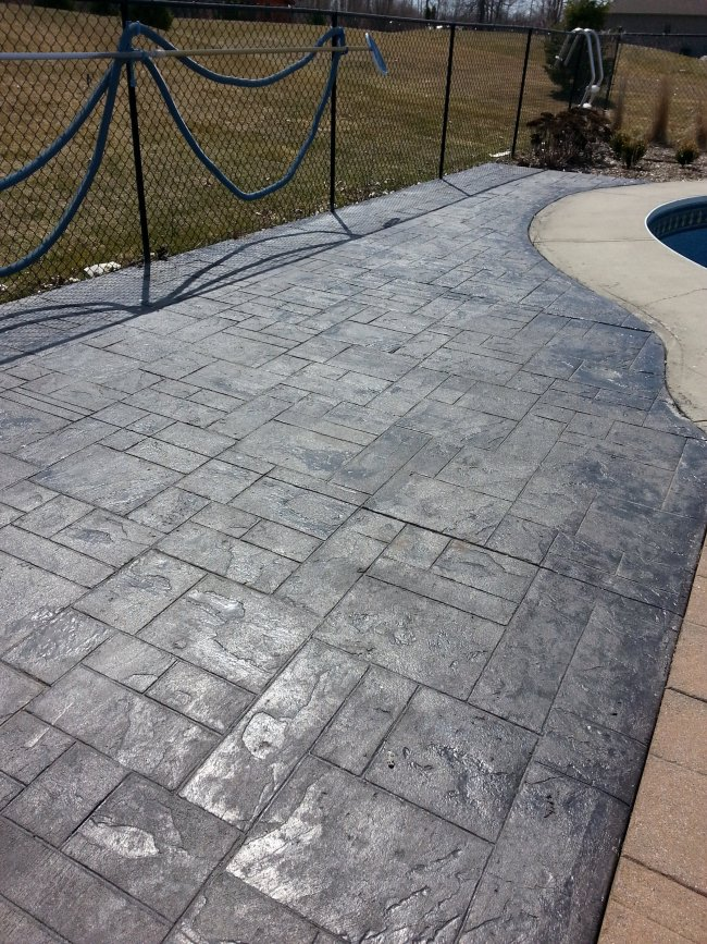 DIY stamped concrete around an inground pool