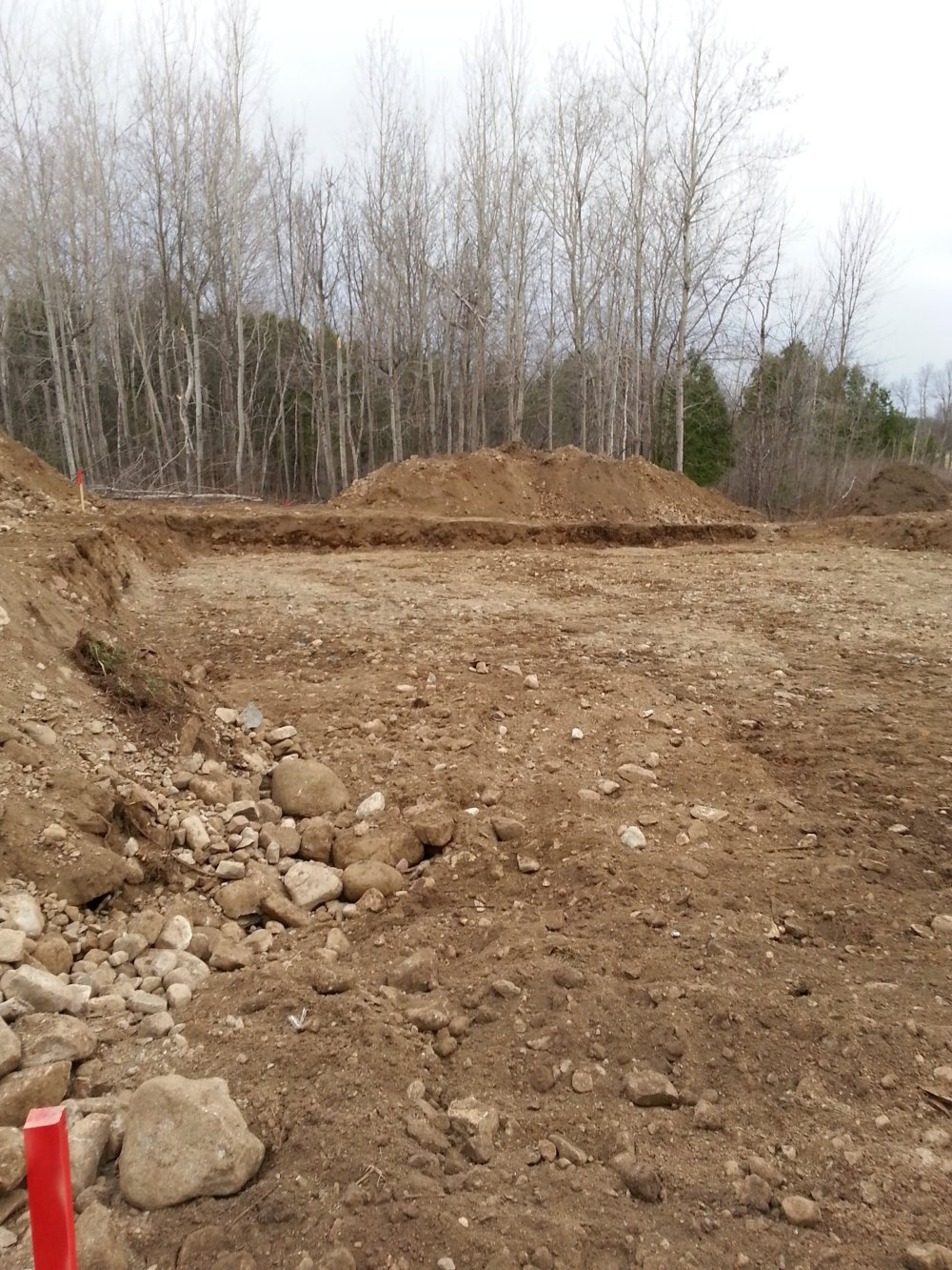 Excavating for an owner builder raised bungalow. How to form and pour footings