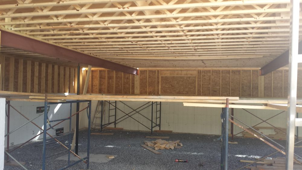 steel beams and floor joists of a new home construction