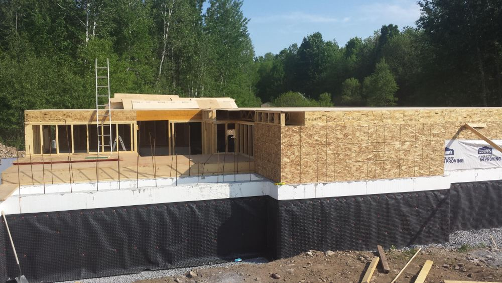 Steel beams, floors joists and subfloor. Owner builder raised bungalow in Ontario, new home construction