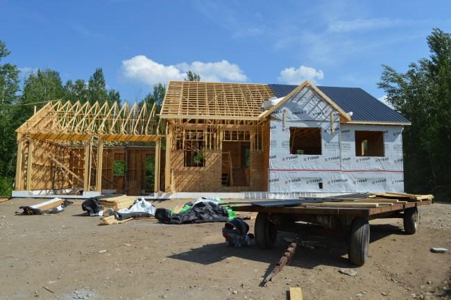 Vicwest black tin roof. Owner builder raised bungalow Ontario