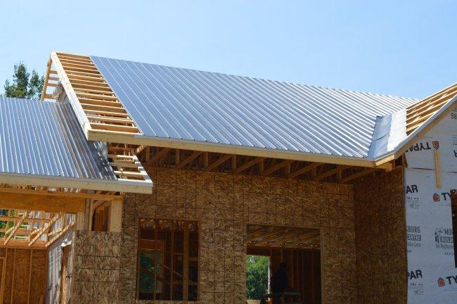 black metal roof. Owner builder raised bungalow