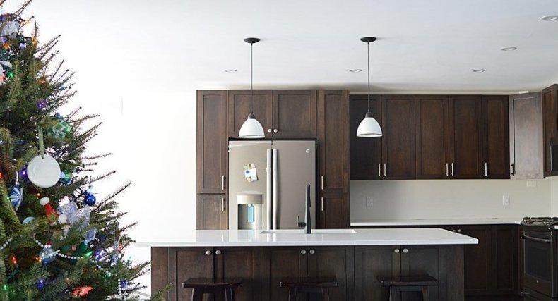 dark stained maple shaker kitchen with quartz counter