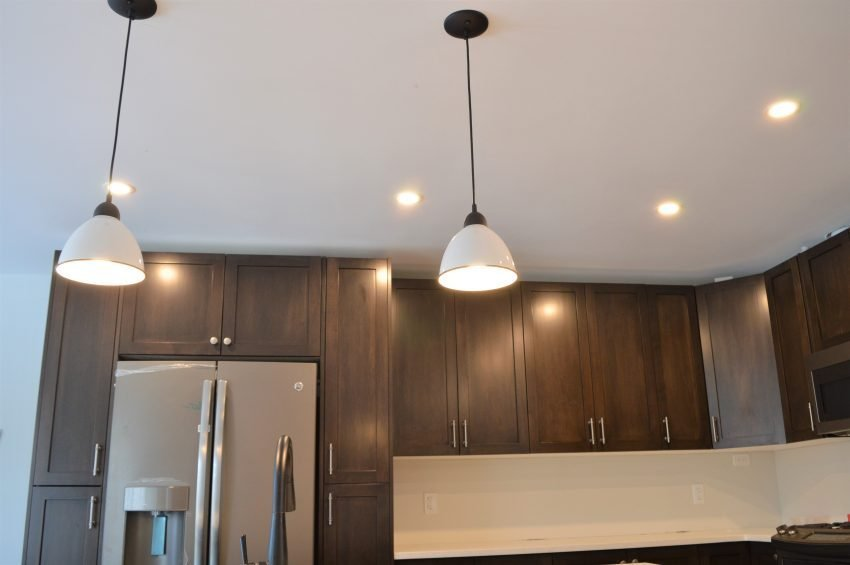 adding layered lighting to create a cohesive kitchen design