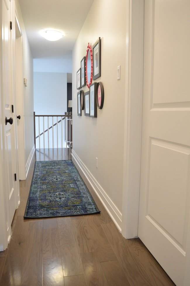 Hall makeover with colorful gallery wall and blue and green runner