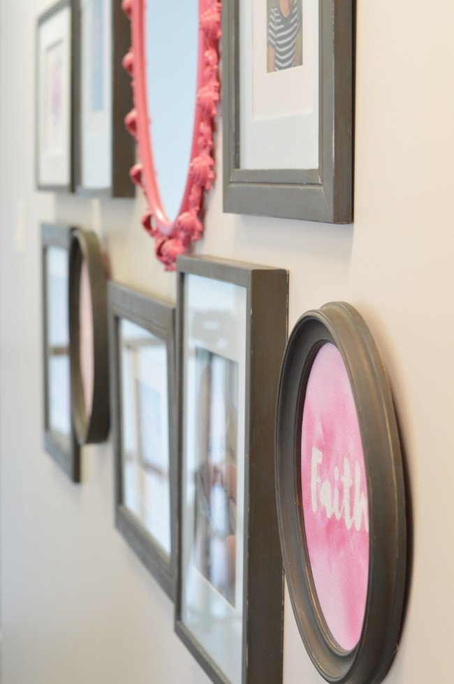 Blue and pink gallery wall with antique mirror