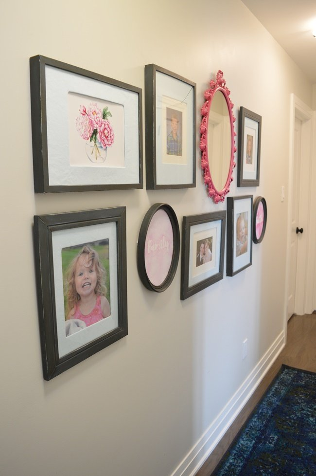 Blue pink and green gallery wall with antique mirror