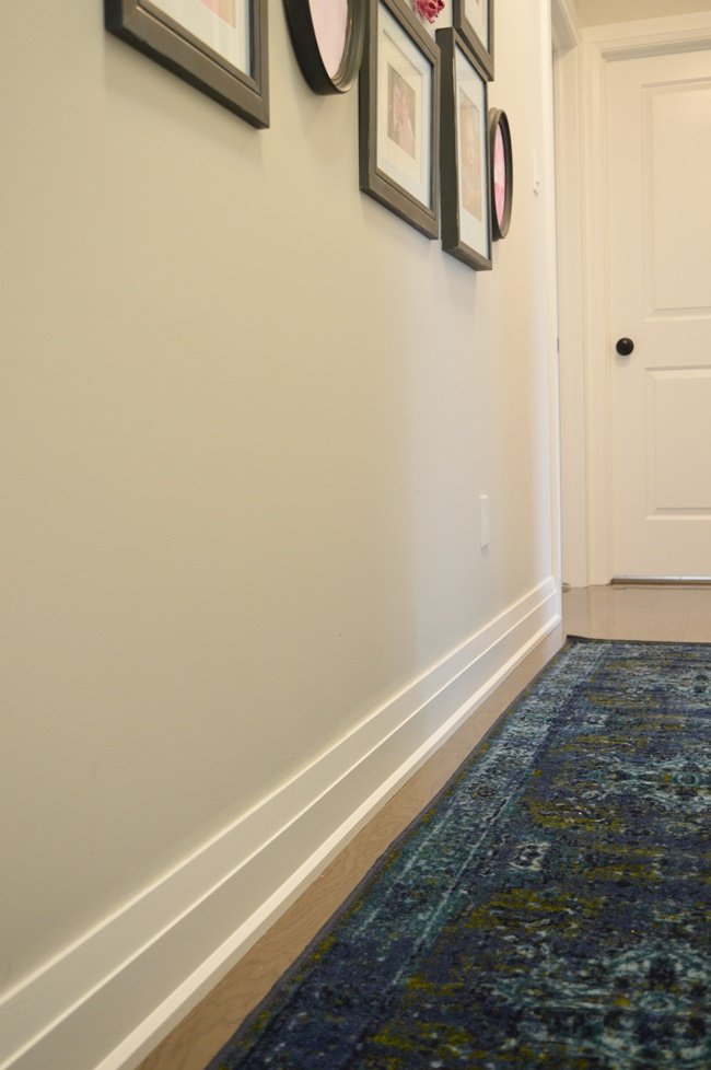 Benjamin Moore Intense White wall paint with Chantilly Lace on the trim