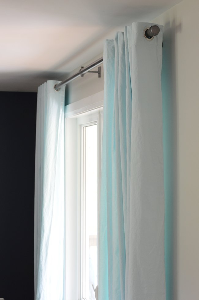 Industrial curtain rods with aqua blue curtains