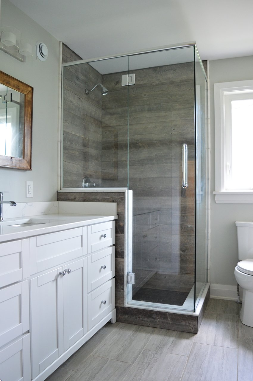White and grey bathroom with wood look tile shower