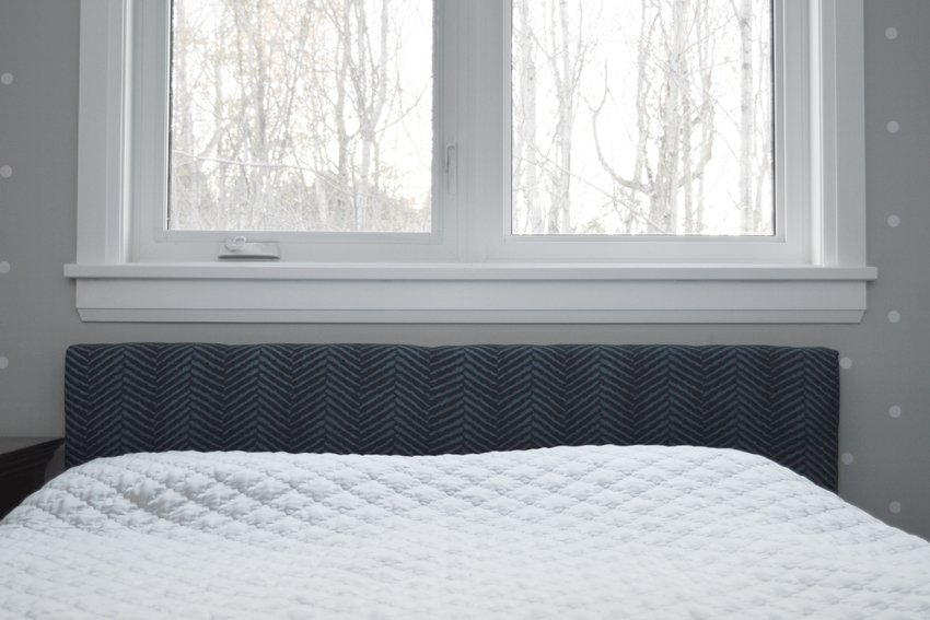 bed makeover using navy blue herringbone fabric