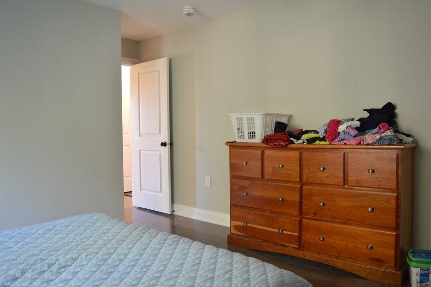 cherry dresser in a master bedroom