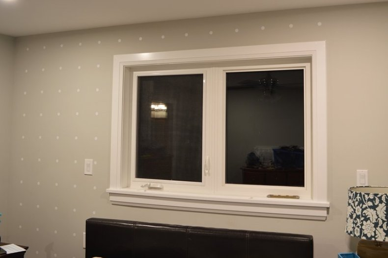 white dot accent wall master bedroom