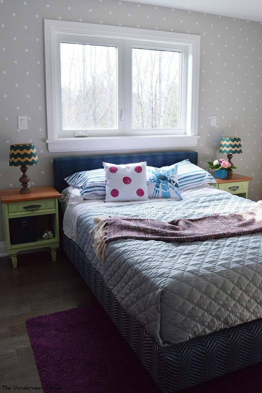 master bedroom with polka dot accent wall