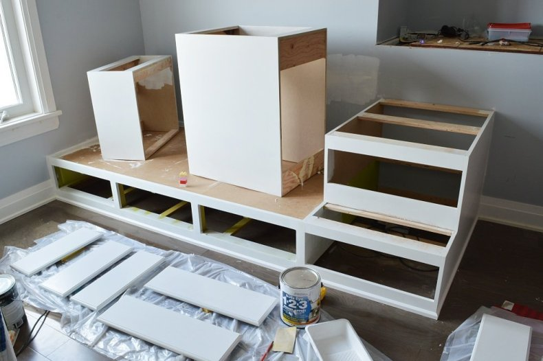 Priming and painting custom builtin beds for a shared boys bedroom makeover
