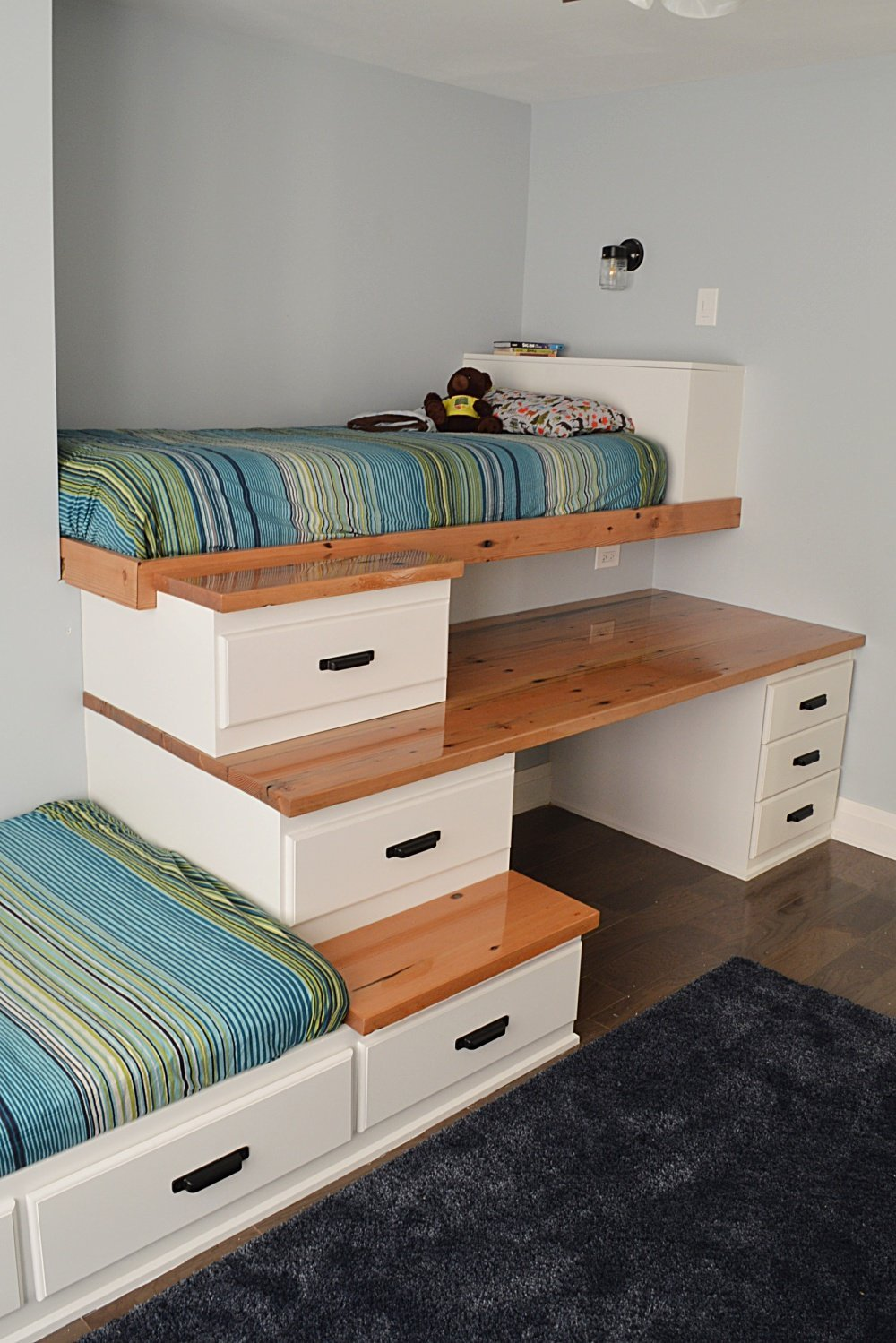 built in bed with storage for a shared boys bedroom