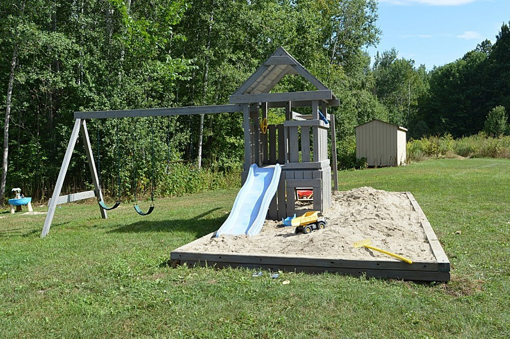 outdoor play structure makeover using semi-transparent stain. before and after swing set makeover