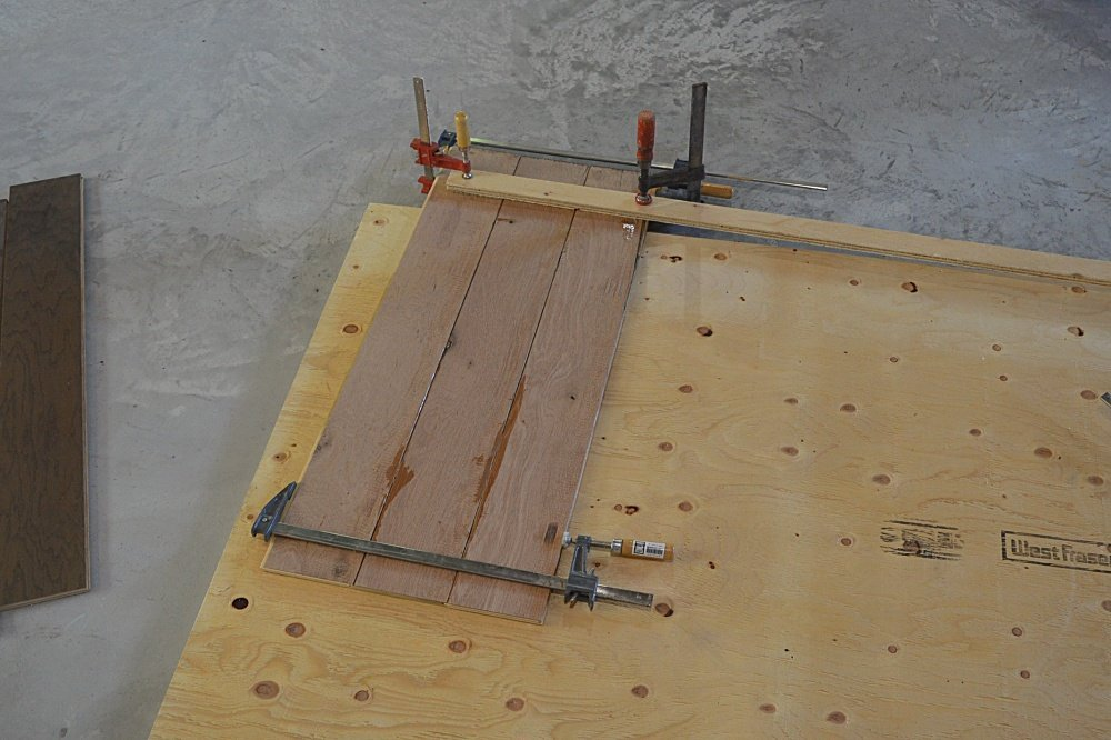 how to make a DIY farmhouse bed from hardwood flooring