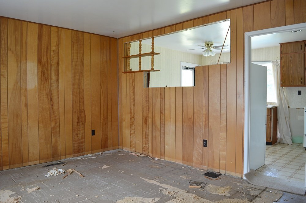 rental house renovation with wood panel walls
