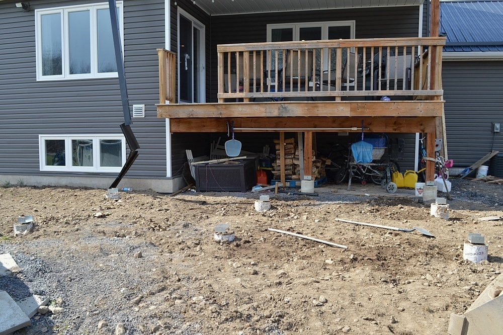 backfilled deck footings and sonotubes